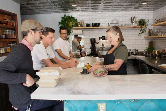 JessicaFurui (right) serves customers at Family, her Japanese-inspired cafe in North Beach.