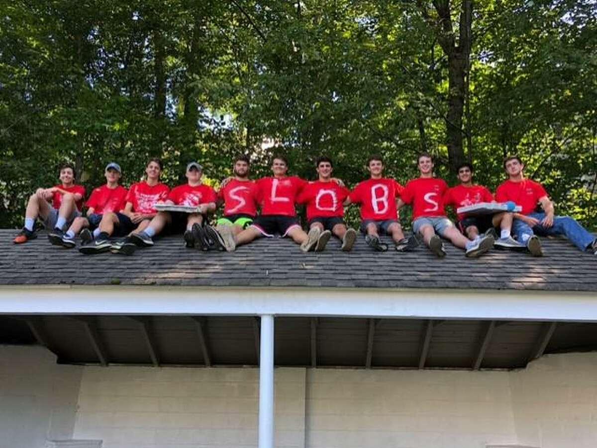 Members of the NCHS SLOBs help refurbish The Lions Den at Mill Pond Park in conjunction with the New Canaan Lions Club on Sunday, Sept. 22.