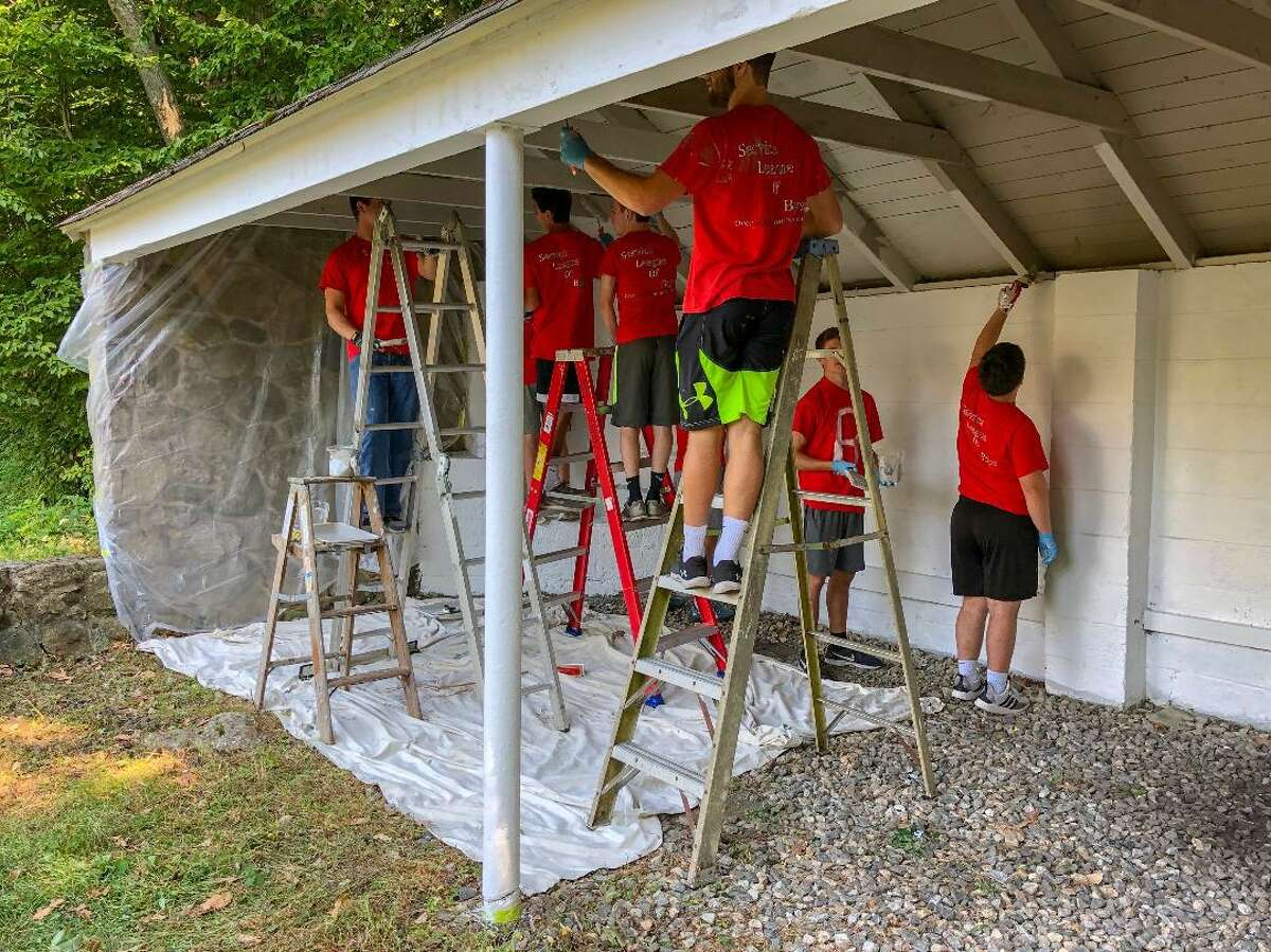 New Canaan Lions Club and NCHS SLOBs working together at the Lion's Den at Mill Pond on Sunday, Sept. 22.
