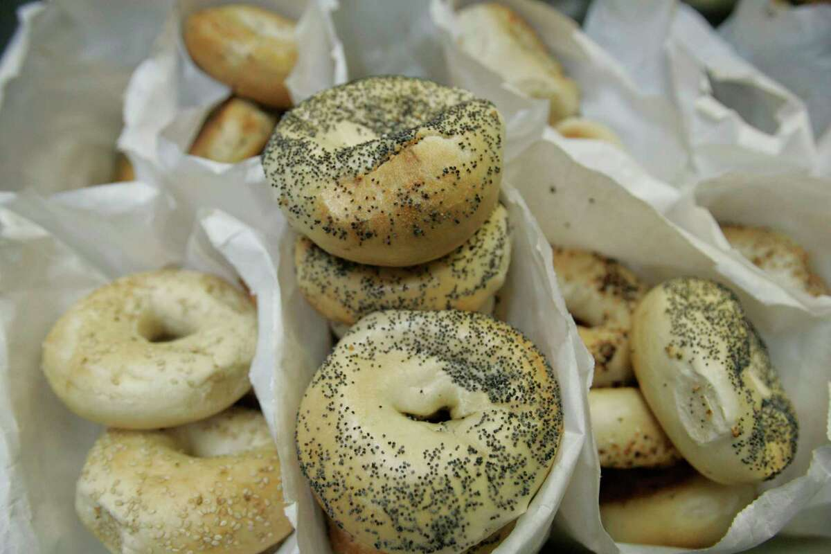 Bags of fresh bagels sit in the back kitchen New York Bagels Inc. on Hillcroft.