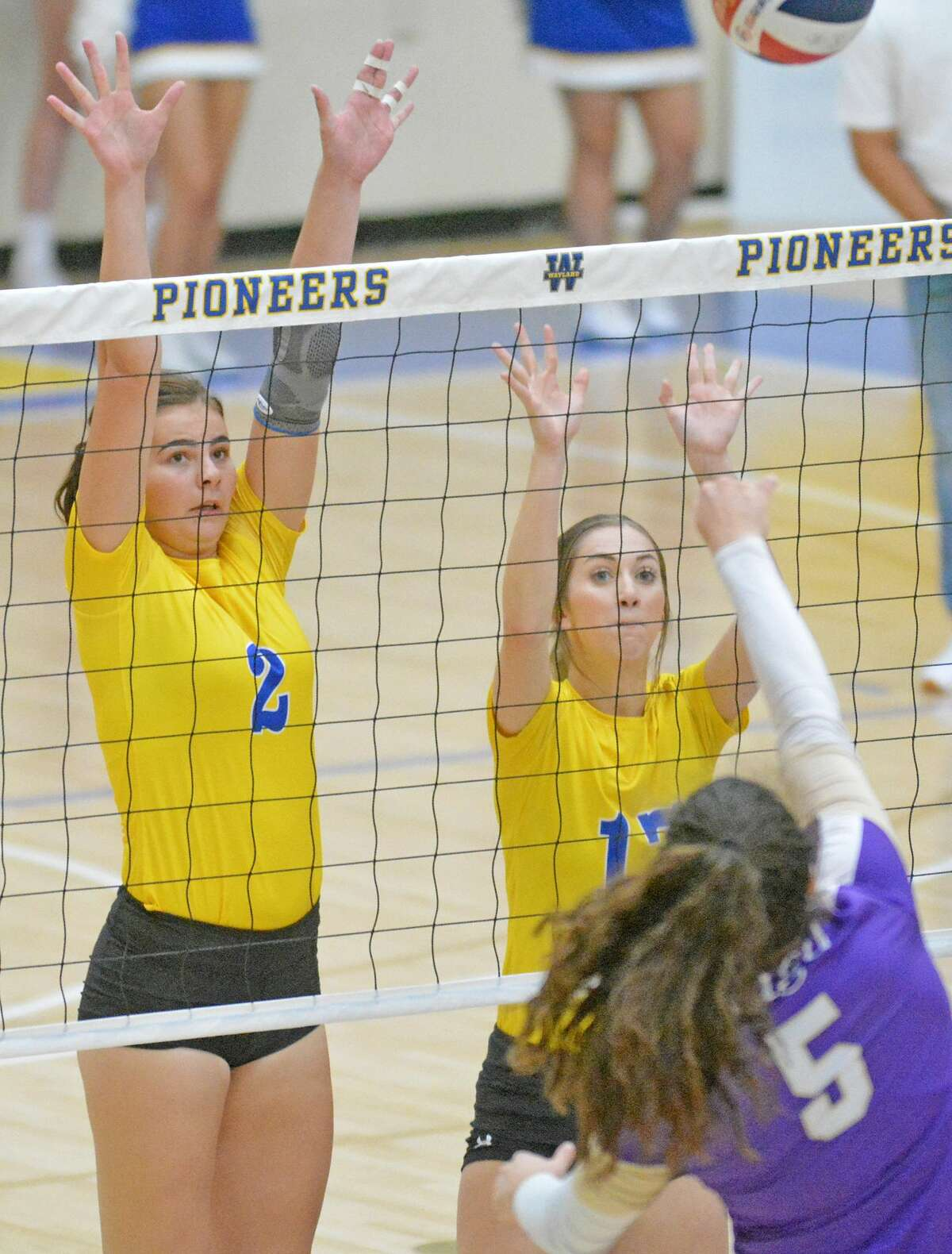 Wayland Baptist players Charm Henderson (2) and Sadie Hall attempt to block the hit from Southwestern Assemblies of God's Ava Myers during their Sooner Athletic Conference volleyball match on Saturday afternoon in the Hutcherson Center.