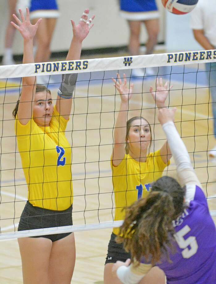 Wayland Baptist players Charm Henderson (2) and Sadie Hall attempt to block the hit from Southwestern Assemblies of God's Ava Myers during their Sooner Athletic Conference volleyball match on Saturday afternoon in the Hutcherson Center. Photo: Nathan Giese/Planview Herald