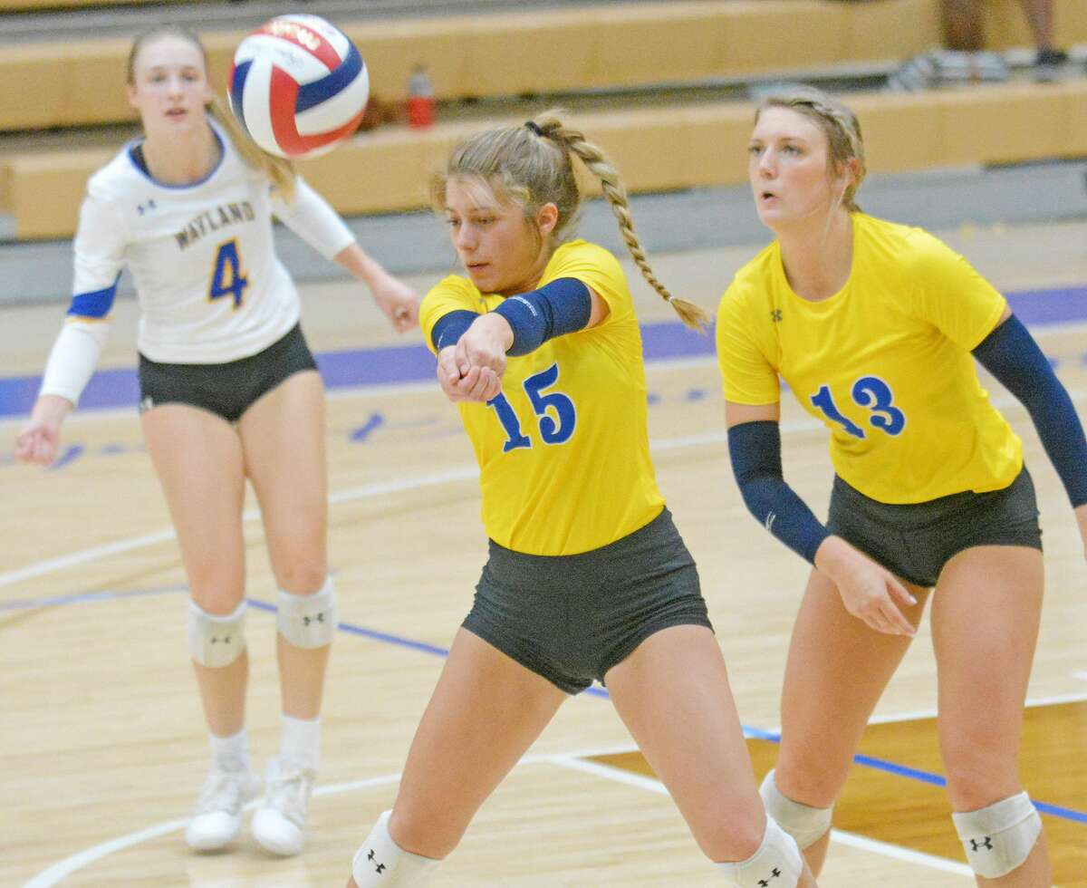 Wayland Baptist's Tevia Bell keeps the ball alive as teammates Jordan Breding and Amber Daniel look on.