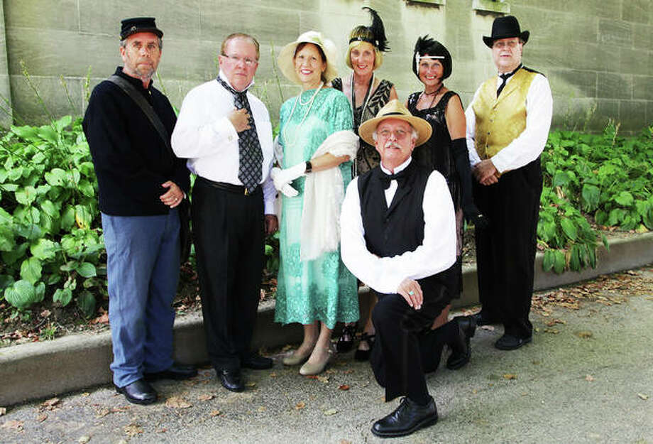 Cast members from this year's Vintage Voices — a historic walking tour featuring stories of Alton's past told by local actors at Alton Cemetery on 5th and Vine Streets — including, from left, Lief Anderson, John Meehan, Claudia Herndon, Margaret Hopkins, Tom Harris, Debbie Schuneman and Kerry Miller. Photo: Jeanie Stephens|The Telegraph