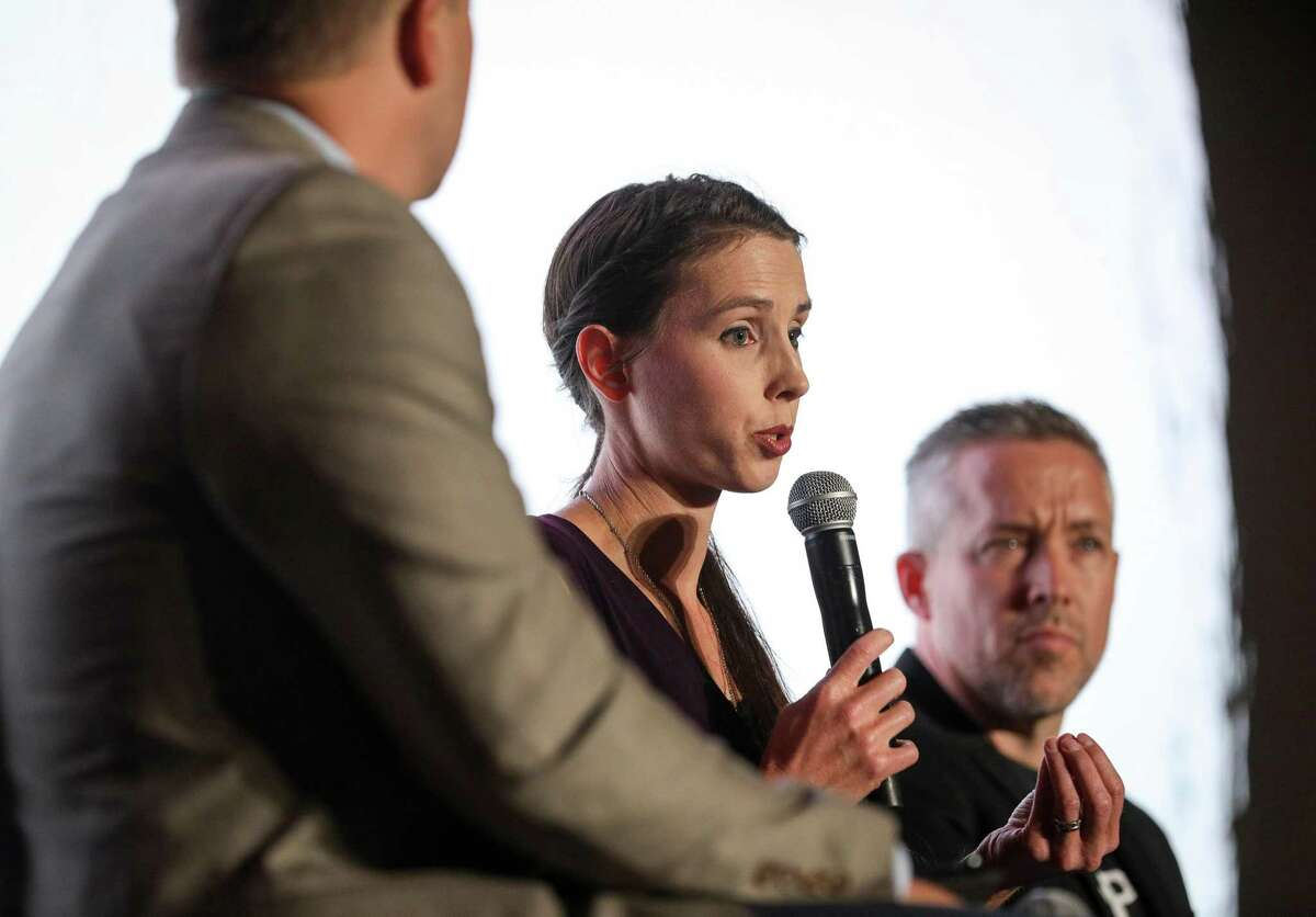 Rachael Denhollander, center, an abuse survivor, speaks about sexual abuse as J. D. Greear, right, president of the Southern Baptist Convention, listens during a panel discussion about sexual abuse and the SBC, on the eve of the SBC's annual meeting on Monday, June 10, 2019, in Birmingham.