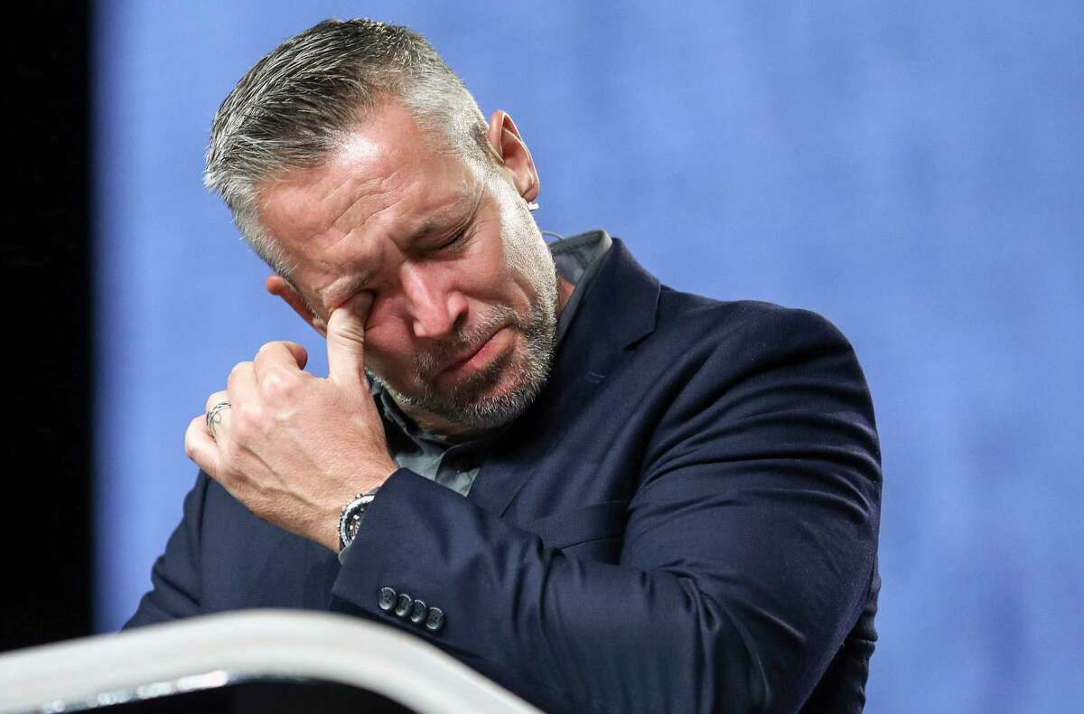 J. D. Greear, president of the Southern Baptist Convention, becomes emotional while talking about sexual abuse within the SBC on the second day of the SBC's annual meeting on Wednesday, June 12, 2019, in Birmingham, Ala. Greear has apologized for the sexual abuse crisis besetting his denomination and outlined an array of steps to address it. ( Jon Shapley/Houston Chronicle via AP)