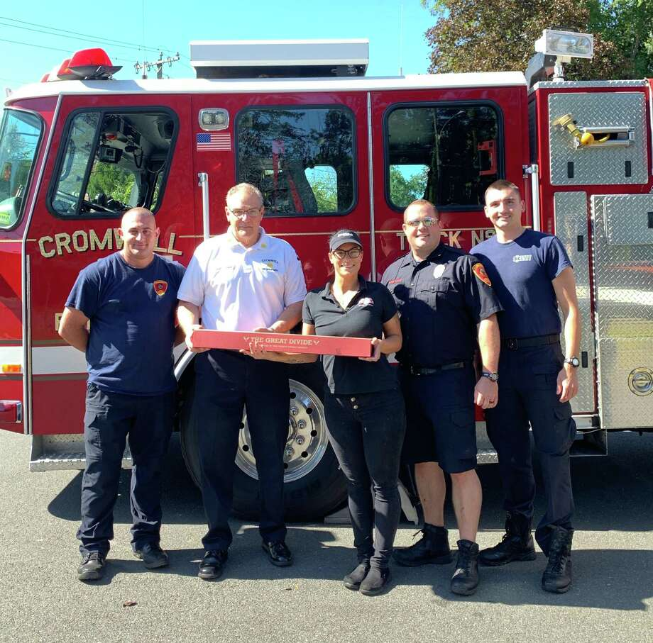 "D'Angelo of Cromwell donated 29"" Great Divide Sandwiches to members of the Cromwell Fire Department, from left, Chief Michael Terenzio, firefighter/EMTs Alan Dominy, Michael DePaolo and John Nowik. Photo: Contributed Photo"