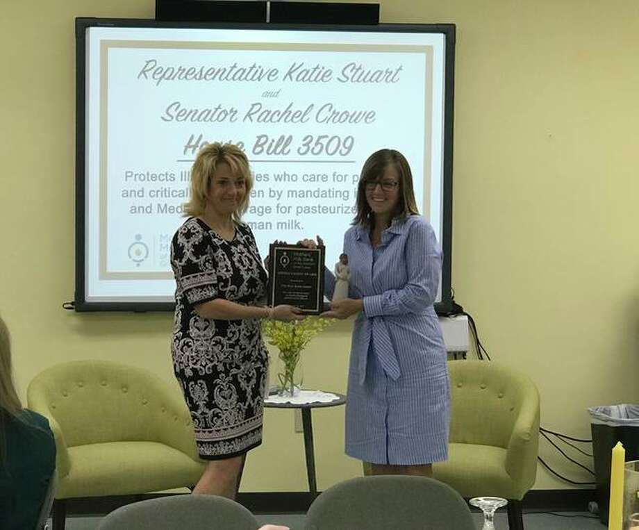 Rep. Katie Stuart (right) receives the Mothers' Milk Bank of the Western Great Lakes Appreciation Award from Margaret Vaughn (left). Photo: For The Intelligencer