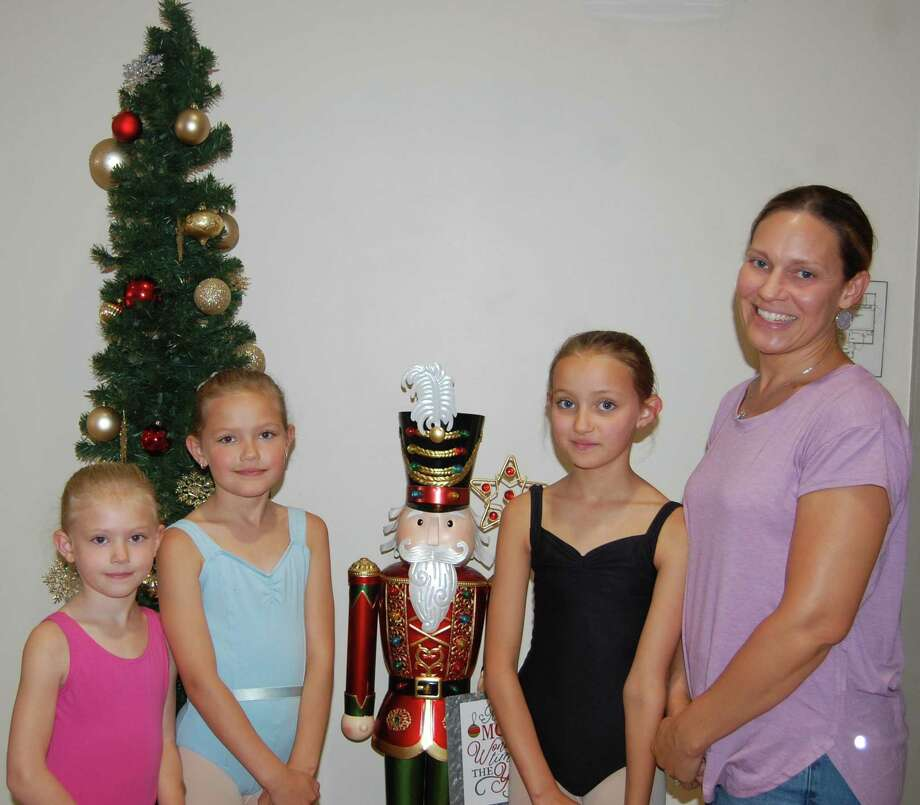 "From left, Ainsley Kinsella, 6; Maeve Kinsella, 8; and Rowan Kinsella, 10, pose next to their mother, Britton Kinsella, all of Goshen, moments before auditioning for roles in Nutmeg Ballet's all-new ""Nutcracker"" last week at the Nutmeg Conservatory. Britton appeared in previous productions and said she is excited that her daughters will be part of Nutmeg's 50th-anniversary celebration by dancing in the first production to feature new scenery and costumes at the Warner Theatre and The Bushnell in December. Photo: Jack Sheedy / Contributed Photo /"