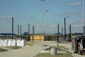Iron poles and shade structures were visible at the baseball/softball diamonds of Plummer Family Park Monday. The park is slated to open sometime in mid-November.