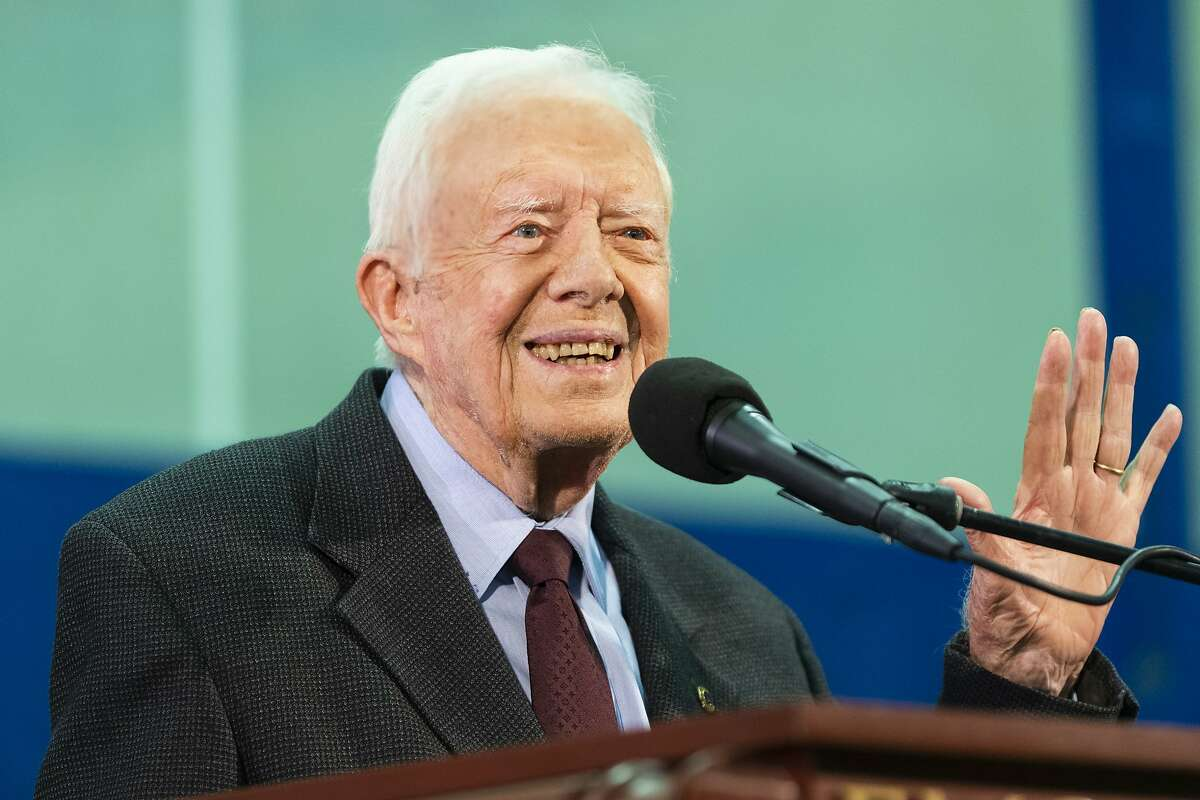 FILE - In this Sept. 18, 2019, file photo former President Jimmy Carter acknowledges a student who's question has been picked for him to answer during an annual Carter Town Hall held at Emory University in Atlanta. Carter turns 95 on Tuesday, Oct. 1. (AP Photo/John Amis, File)