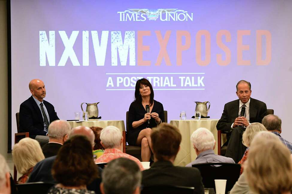 Toni Natalie, center, and Rick Ross, right, join Brendan Lyons for a discussion of NXIVM at the Hearst Media Center on Tuesday Oct. 1, 2019 in Albany, N.Y. (Lori Van Buren/Times Union)