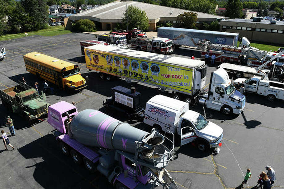 Vehicles similar to these will be on display for children to clamber on, in and around during Edwardsville Township's sixth annual Touch-A-Truck event Saturday.