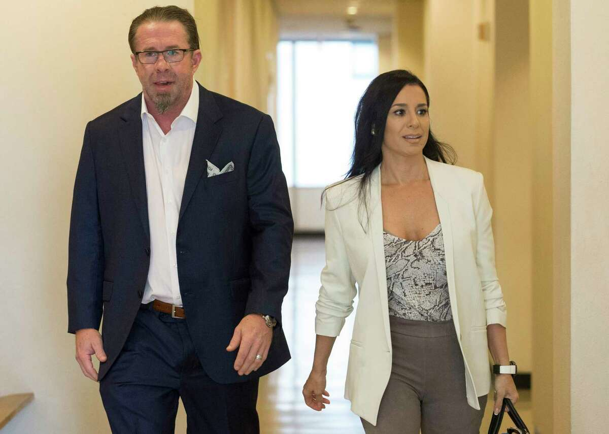 Former Houston Astros player and Hall of Famer Jeff Bagwell arrives the Harris County Family Law Center with wife, Rachel Bagwell, for the opening of his case before Harris County District Judge Latosha Lewis Payne on Tuesday, Sept. 24, 2019, in Houston. F&G Landscape Inc. alleged that the former Astros first baseman owes them $175,800 for works done at Bagwell's $4.8 million home in the Memorial area.
