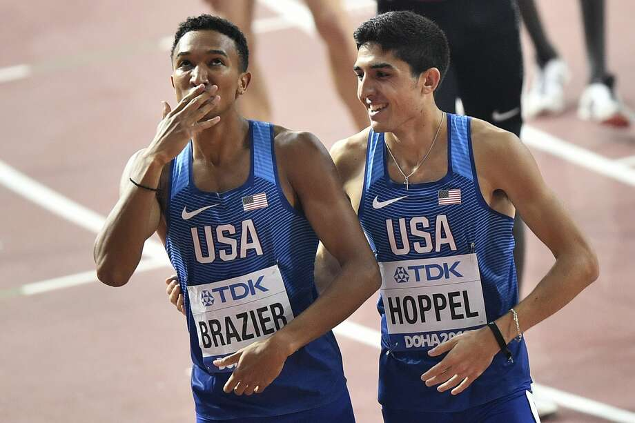 Gold medallist Donovan Brazier, of the U.S., left, blows a kiss as he is congratulated by fellow countryman Bryce Hoppel, right, after the the men's 800 meter final at the World Athletics Championships in Doha, Qatar, Tuesday, Oct. 1, 2019. (AP Photo/Martin Meissner) Photo: Martin Meissner/Associated Press
