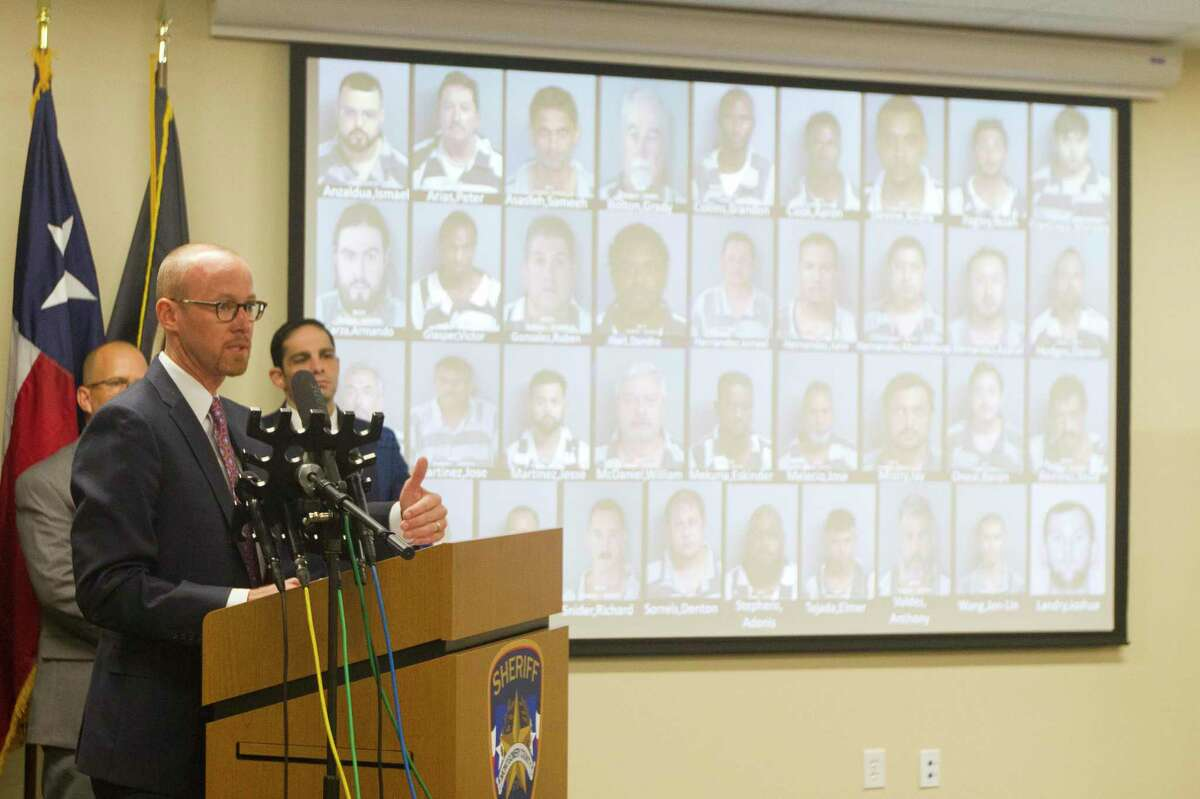 Assistant Montgomery County District Attorney Tyler Duman speaks during a press conference at the Montgomery County Sheriff's Office, Tuesday, Oct. 1, 2019, in Conroe. Seventy-nine people were arrested for human trafficking and prostitution as part of the Sheriff's Office's multi-agency investigation called 'Operation Labour.'