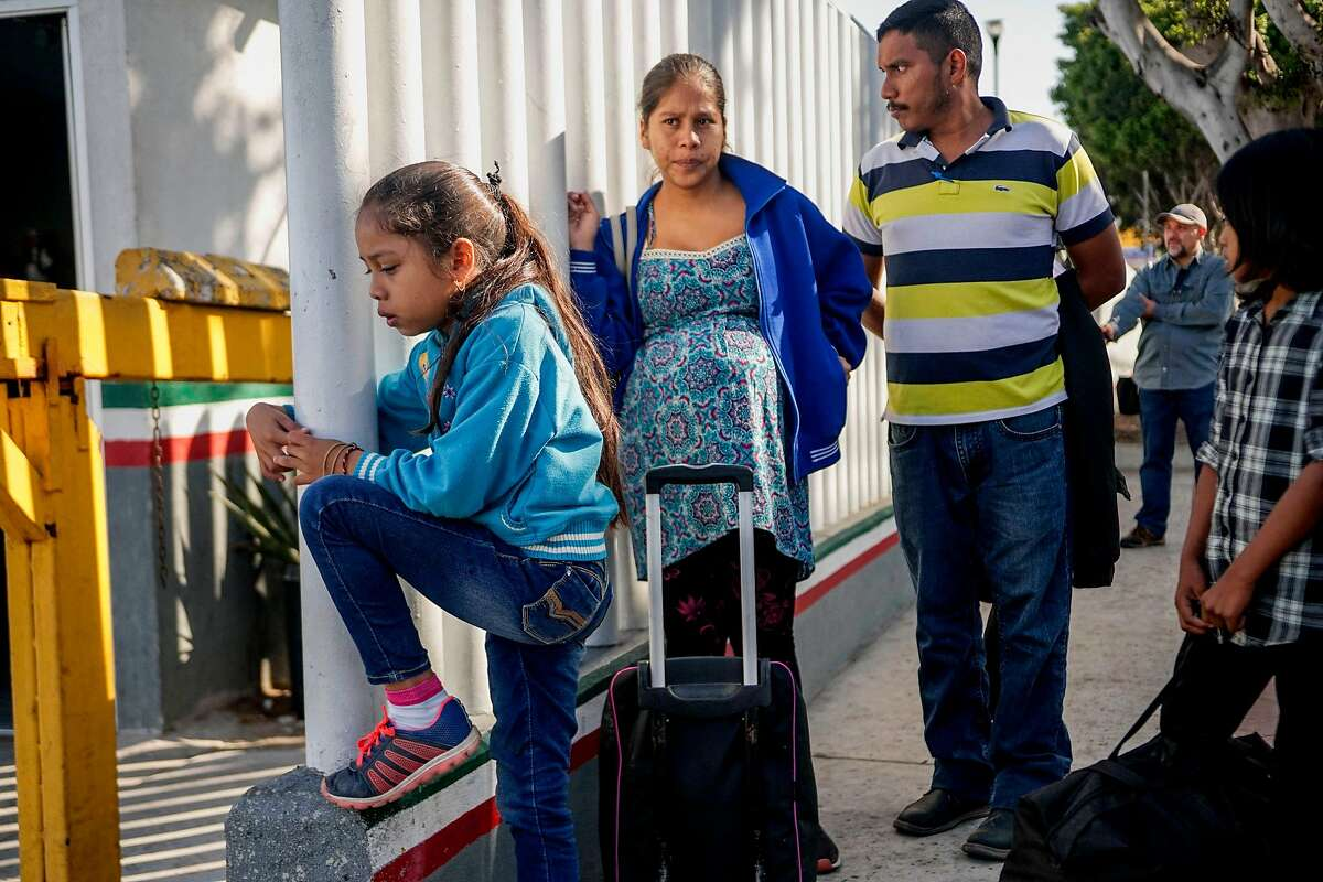 Migrants from Honduras wait in line at the Mexico-United States border crossing in Tijuana, Mexico on September 12, 2019. - With a little help from the Supreme Court and Mexico, US President Donald Trump's fitful crackdown on immigration is finally gaining traction. Trump has spent his entire presidency promising to stop illegal immigration, shut out asylum seekers and wall off the Mexican border.The latest boost came Wednesday when the Supreme Court said he could enact severe restrictions on asylum seekers. The ruling requires would-be refugees to ask for asylum in the first country they visit and only then -- if they are rejected -- can they attempt to apply in the United States. (Photo by SANDY HUFFAKER / AFP)SANDY HUFFAKER/AFP/Getty Images