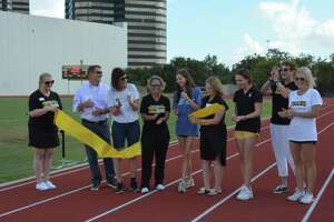 St. Agnes Academy track and field and cross-country athletes, parents, coaches, school officials, donors and others gather to celebrate their newly improvedEast Campus Athletics Complex on Monday, Sept. 30. It is the first time, the girls have had a home of their own to practice and compete.