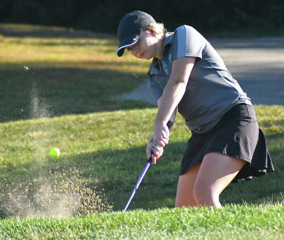 Edwardsville's Katie Baker hits her shot out of the bunker and onto the 18th green at Far Oaks in the Southwestern Conference Tournament on Tuesday. Photo: Matt Kamp|The Intelligencer