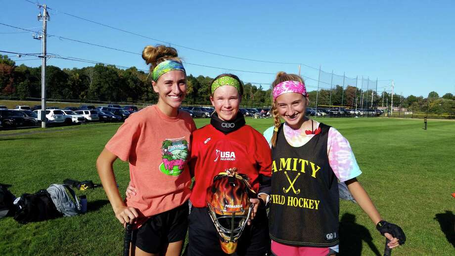 From left, Amity's Morgan Rahn, Payton Rahn and MaCaelan Rahn. Photo: Dan Nowak / Hearst Connecticut Media