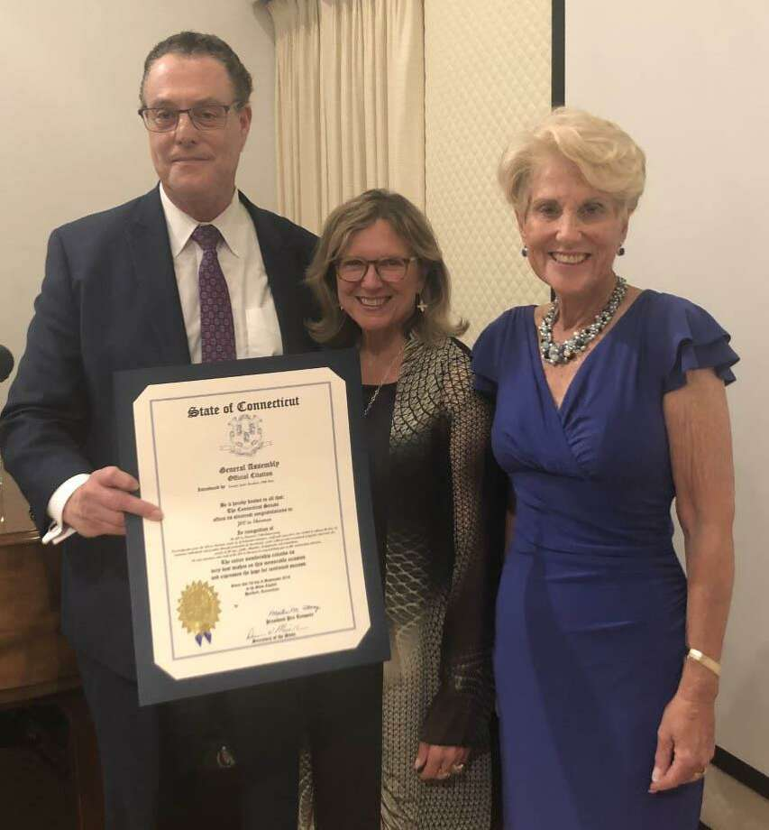 Henry Cooperman, president of the Jewish Community Center in Sherman, and Barbara Ackerman, past president, right, receive an official citation from the State General Assembly, presented by State Senator Julie Kushner, at the recent JCC anniversary party. Photo: Courtesy Of Jewish Community Center In Sherman / The News-Times Contributed