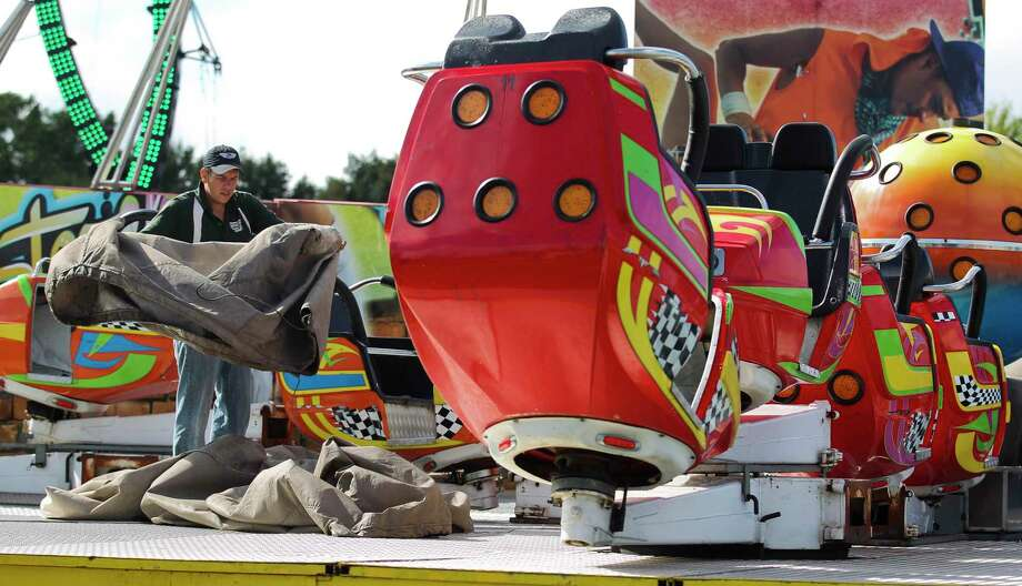 Workers setup carnival rides in preparation for this weekend's annual Conroe Cajun Catfish Festival, Wednesday, Oct. 10, 2018, in downtown Conroe. The event runs Oct. 12 - 14 with admission for children under 12 free and general admission is $15 at the gate. Photo: Jason Fochtman, Houston Chronicle / Staff Photographer / © 2018 Houston Chronicle