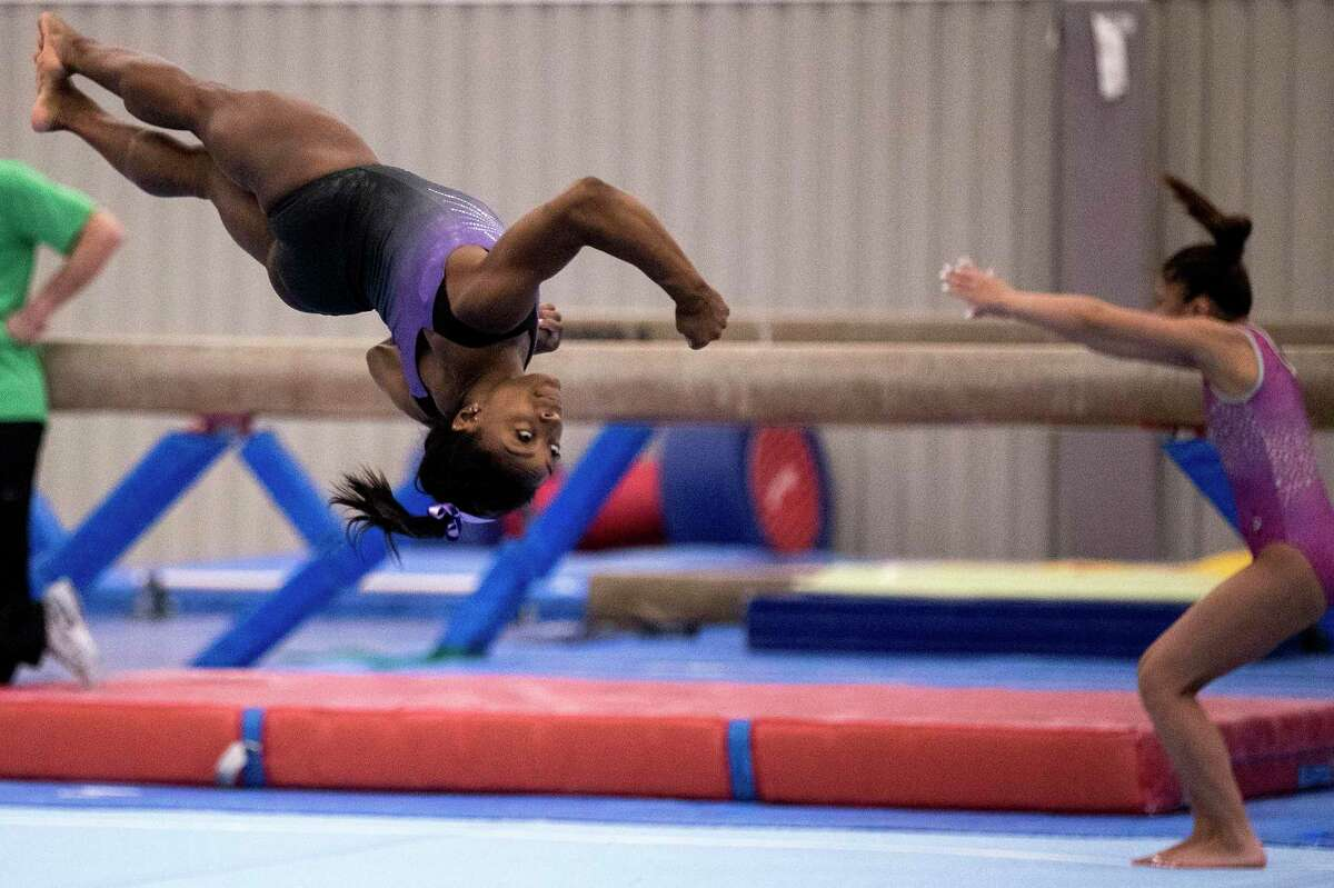 Olympic champion Simone Biles works out earlier this summer the at World Champions Centre as she prepares for upcoming competitions.