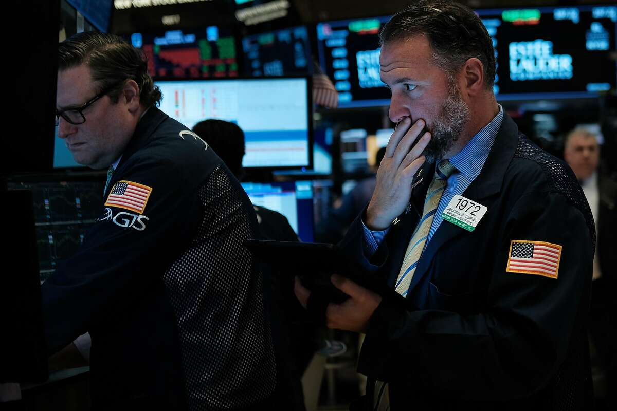 NEW YORK, NEW YORK - OCTOBER 01: Traders work on the floor of the New York Stock Exchange (NYSE) on October 01, 2019 in New York City. The Dow fell over 300 points on Tuesday following weak manufacturing numbers and continuing concerns over global politics. (Photo by Spencer Platt/Getty Images)