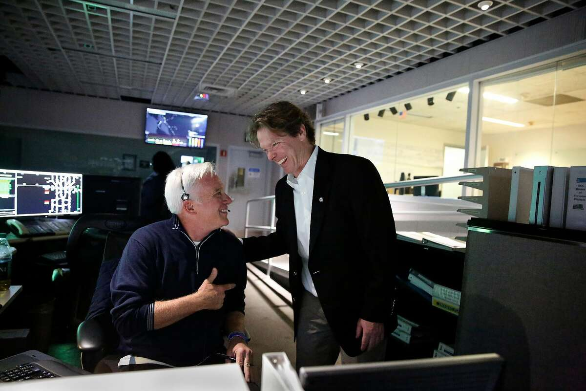 BART General Manager Robert Powers (right) talks with Alan Weinberg (left), train operator at the BART operations control center on Monday, September 30, 2019 in Oakland, CA.