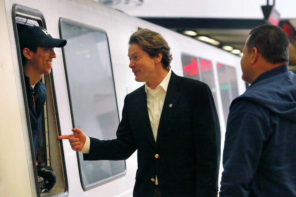 BART General Manager Robert Powers (center) talks with BART train operator Trevor Ho (left) after Powers disembarked at BART�s Lake Merritt Station on Monday, September 30, 2019 in Oakland, CA.