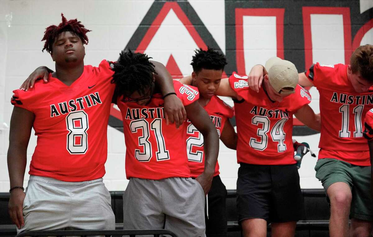 Football players pray for Jordyn Hawkins during a prayer rally. The 15-year-old football player at Fort Bend's Austin High School was left paralyzed after suffering a spinal cord injury during a game.