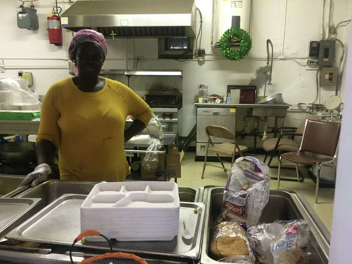 Regina Akot working in the kitchen for the RISSE during the nonprofit's after school programming.