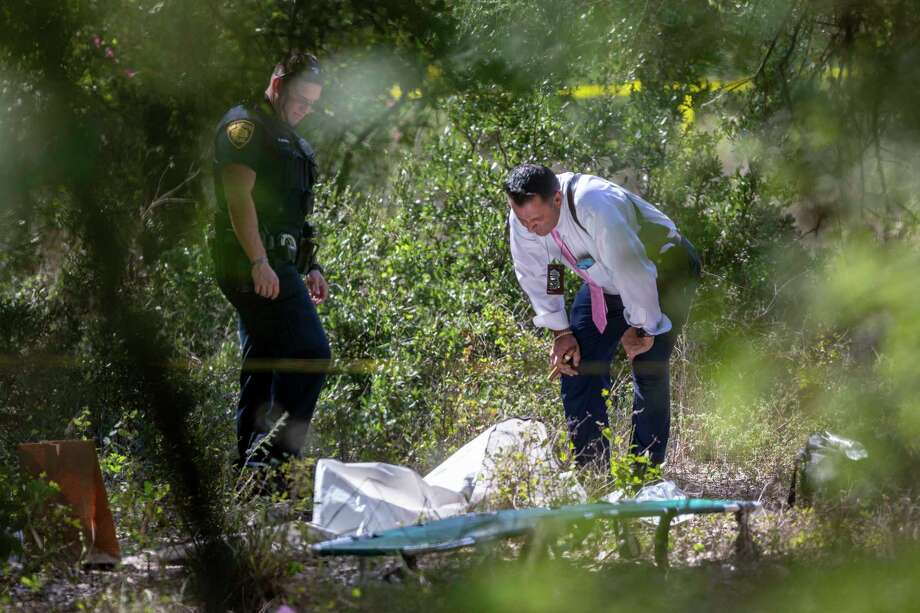 Officials examined human skeletal remains Tuesday, Oct. 1, 2019 on the southwest corner of the intersection of Loop 1604 and Babcock Road. A survey crew found the remains which police say had been there at least six months. Photo: William Luther, Staff / ©2019 San Antonio Express-News