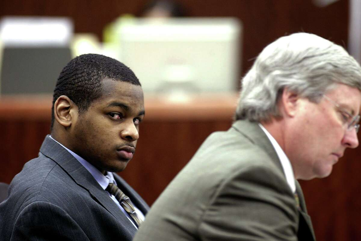 In this Oct. 10, 2005 file photo, Alfred Dewayne Brown, left, is seated next to defense attorney Robert Morrow, right. Brown was convicted and sentenced to death for the 2003 killing of a Houston police officer, but his conviction was later overturned and he was freed.