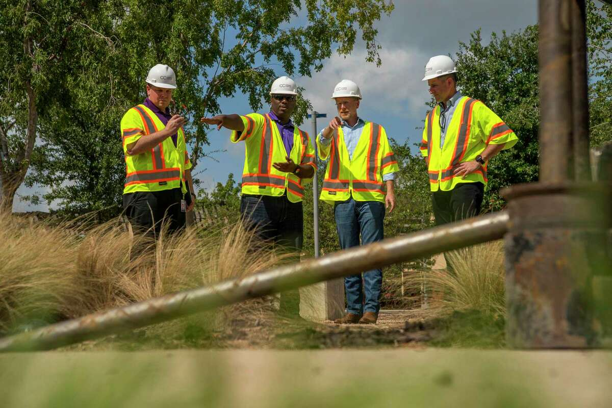 Brendan Carr (second from right), Commissioner of the Federal Communications Commission (FCC), tours a site where work is underway to finish installing fiber that will one day support a 5G network, near Guadalupe Plaza Park in Houston's Second Ward, Monday, Sept. 30, 2019.