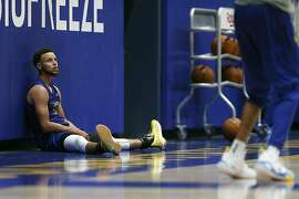 Golden State Warriors' Stephen Curry watches D'Angelo Russell during training camp at Chase Center in San Francisco, Calif., on Tuesday, October 1, 2019.
