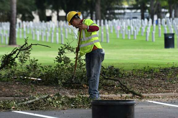 Crew members from Trees, Inc. participate in the 5th Annual Saluting Branches Day of Service at the Houston National Cemetary in Houston onOct. 1, 2019.
