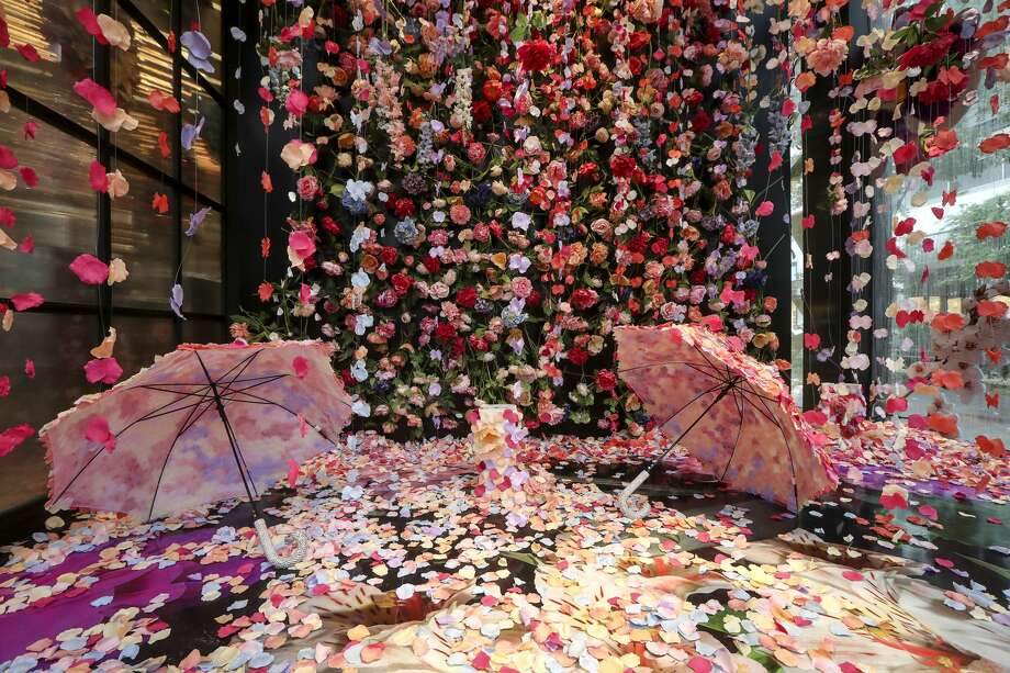 """Flower Rain"" is a photo-booth installation made of hanging silk petals, inside of the Avant Garden at ROD, a floral store in River Oaks District. Photo: Jon Shapley/Staff Photographer"