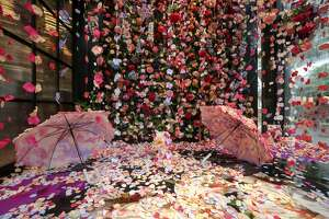 """""""Flower Rain"""" is a photo-booth installation made of hanging silk petals, inside of the Avant Garden, a floral store in River Oaks District. It was photographed on Tuesday, Sept. 17, 2019, in Houston."""