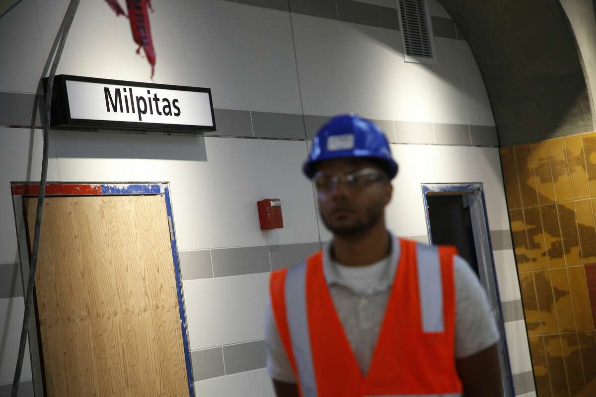 FILE - Outreach Coordinator Nicolas Townes is photographed on a rider platform in the Milpitas BART Station on Tuesday, Aug. 22, 2017, in Milpitas, Calif. The final opening dates of the Milpitas and Berryessa stations are still being solidified.