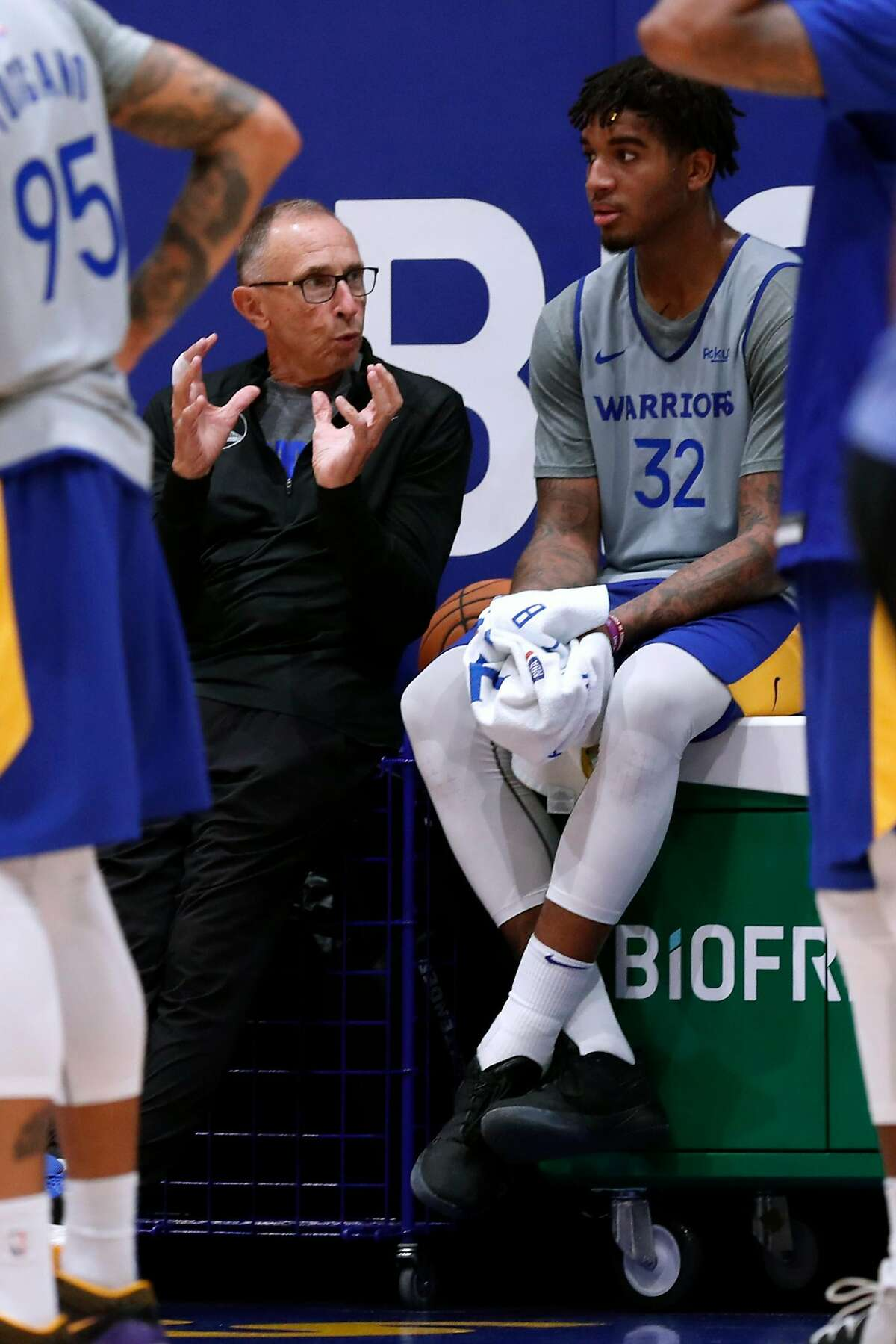 Golden State Warriors' assistant coach Ron Adams instructs Marquese Chriss during training camp at Chase Center in San Francisco, Calif., on Tuesday, October 1, 2019.