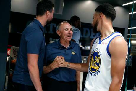 Golden State Warriors' assistant coach Ron Adams greets Stephen Curry during media day at Chase Center in San Francisco, Calif., on Monday, September 30, 2019.