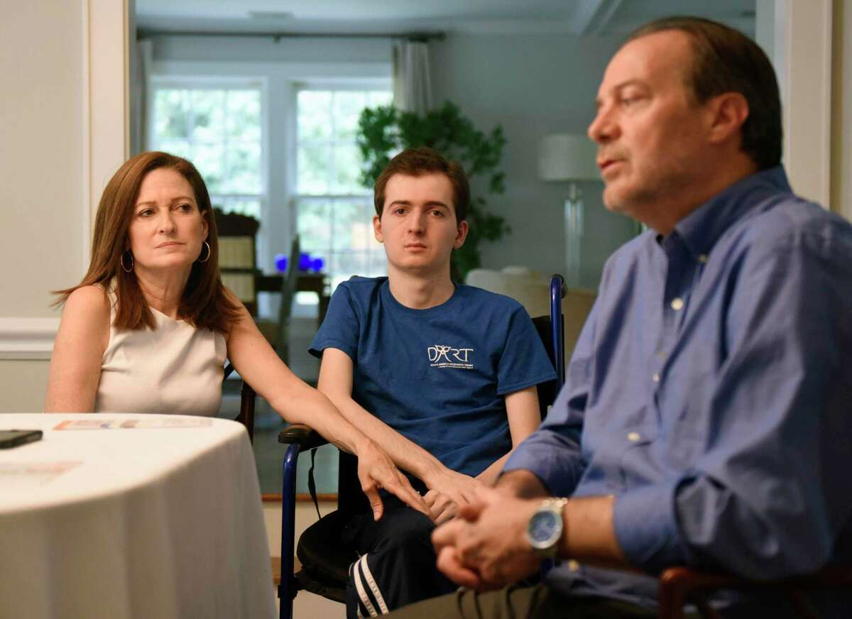 Andrea Marella and Phil Marella chat with their son Andrew, center, 20, at their home in Greenwich, Conn. Monday, Sept. 23, 2019. Andrew has a rare progressive genetic disorder called Niemann-Pick disease type C (NPC), which took the life of his sister, Dana, in 2013. The Marella's non-profit Dana?'s Angels Research Trust (DART) raises money to research the disease and is holding the DART to the Finish charity walk at Greenwich Point Park on Saturday, Oct. 5.