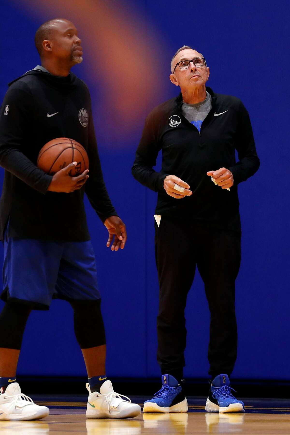 Golden State Warriors' assistant coach Ron Adams (right) during training camp at Chase Center in San Francisco, Calif., on Tuesday, October 1, 2019.