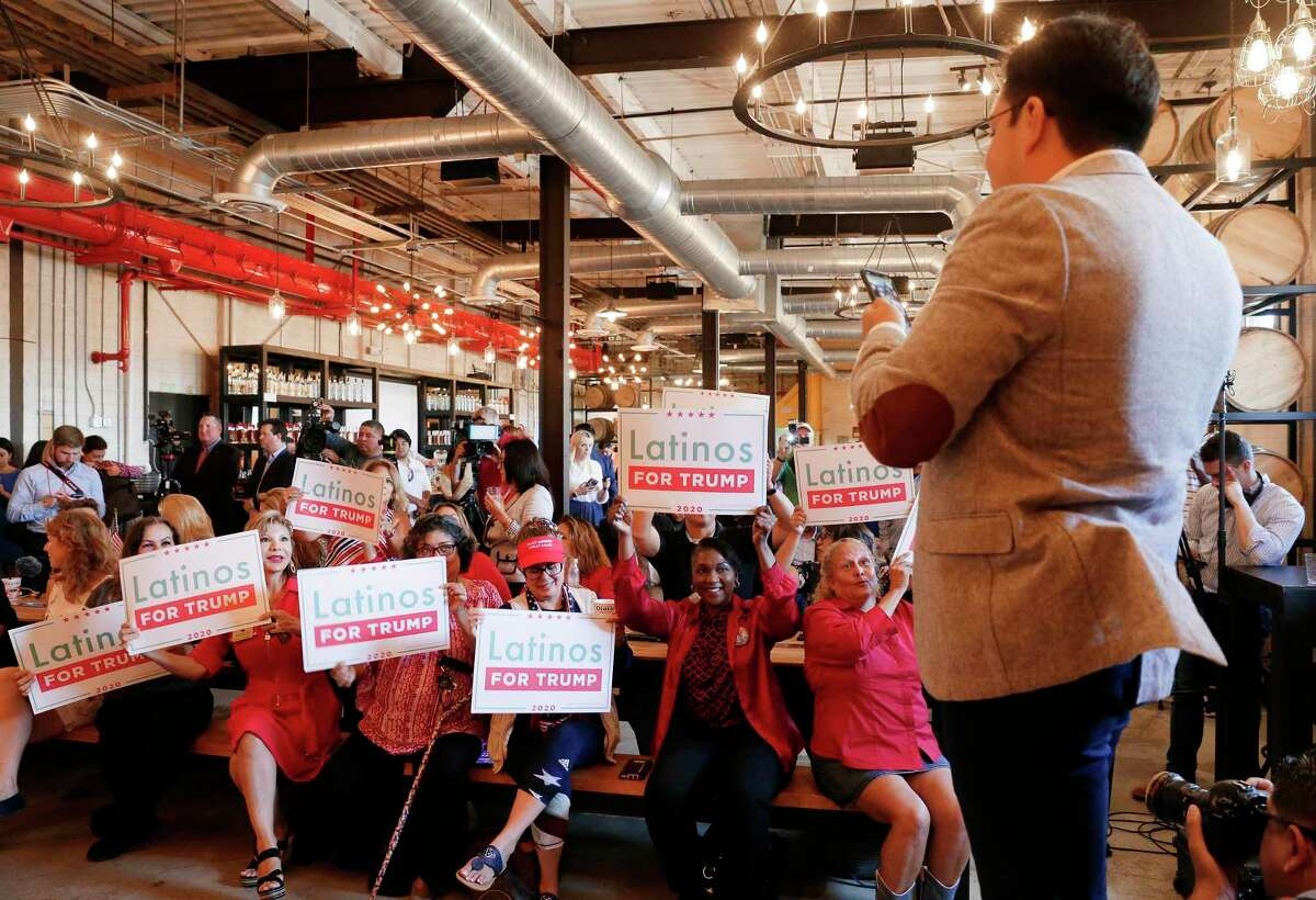 """Juan Mejia, deputy executive director of """"Latinos for Trump"""" for the campaign, pumps up the crowd for a phone photo during a GOP Trump rally at the Gulf Coast Distiller to counter the democratic candidates debateThursday, Sept. 12, 2019 in Houston, TX."""