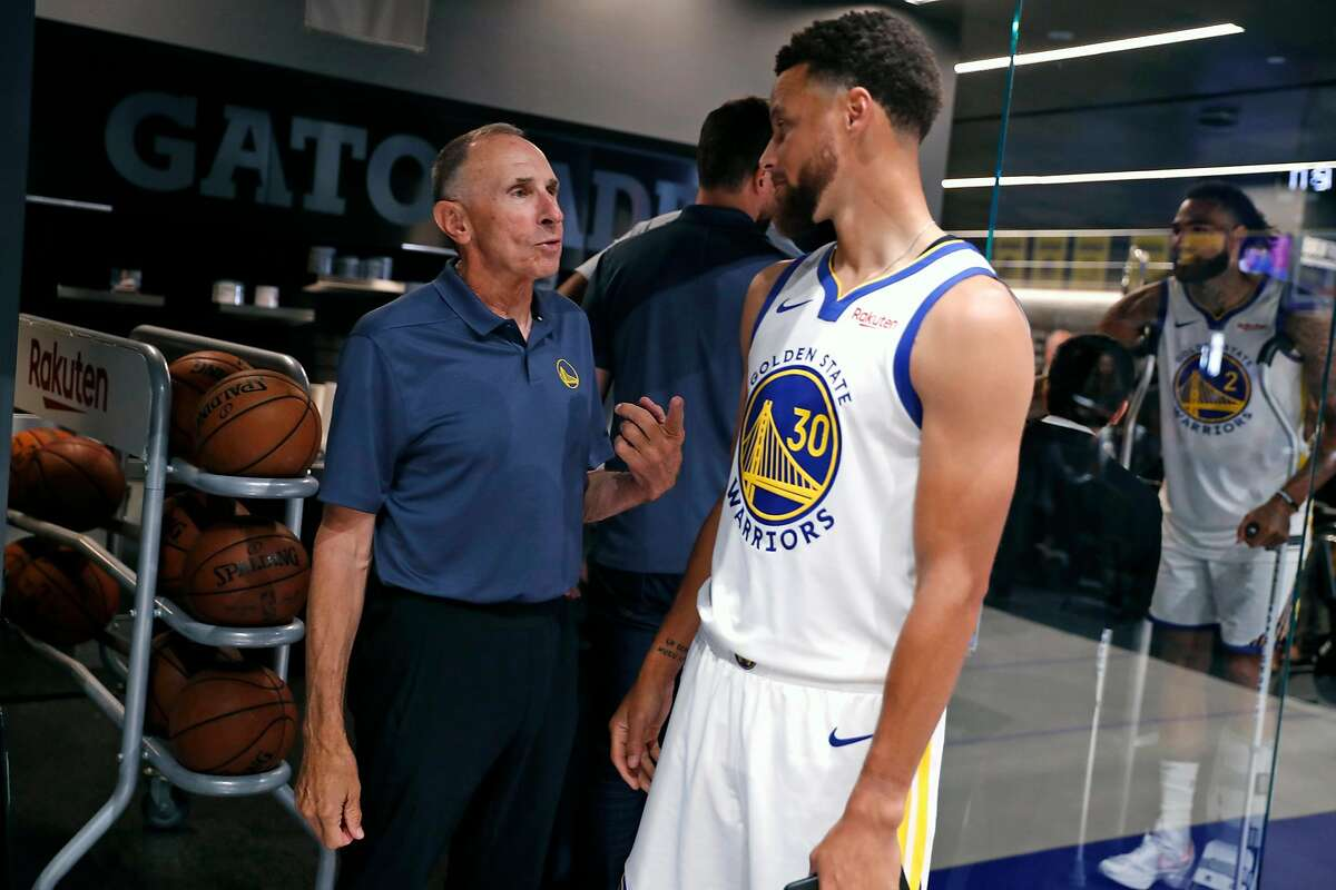 Golden State Warriors' assistant coach Ron Adams talks with Stephen Curry during media day at Chase Center in San Francisco, Calif., on Monday, September 30, 2019.