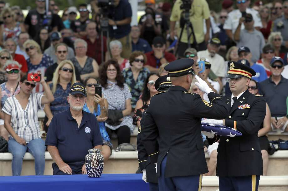 An honor guard holds an American flag during an open funeral service for U.S. Army veteran Edward K. Pearson Tuesday, Oct. 1, 2019, at the Sarasota National Cemetery in Sarasota, Fla. Pearson has no family so his funeral home sent out a request on social media for the public to attend the service. (AP Photo/Chris O'Meara) Photo: Chris O'Meara, Associated Press