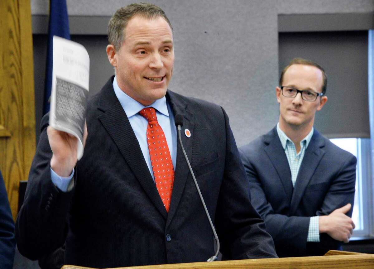 Schenectady County Legislator Rory Fluman, left, and GE's solar product line general manager Erik Schiemann announce a partnership between the county and GE to build a network of solar farms during a news conference Thursday April 26, 2018 in Schenectady, NY. (John Carl D'Annibale/Times Union)
