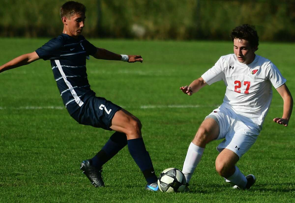 Greenwich's Mattias Lew, right, battles for the ball with Staples' Benny Feuer on Oct. 1.