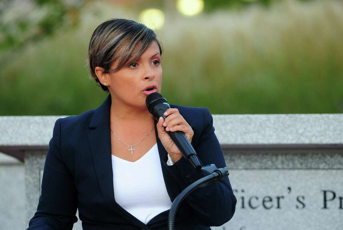 Maritza Bond speaks during the Center for Family Justice's Domestic Violence Awareness Vigil at the Bridgeport Police Department memorial in Bridgeport, Conn., on Tuesday Oct. 1, 2019.